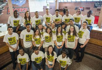 Group of students wearing no place for hate shirts